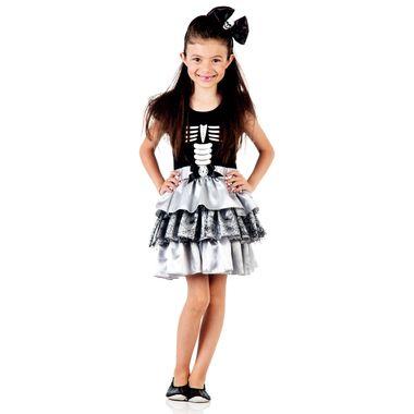 Menina usando vestido infantil esqueleto para festas fantasias